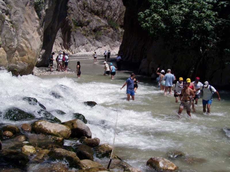 Saklikent Gorge, Turkey - People walking through the cold, running water