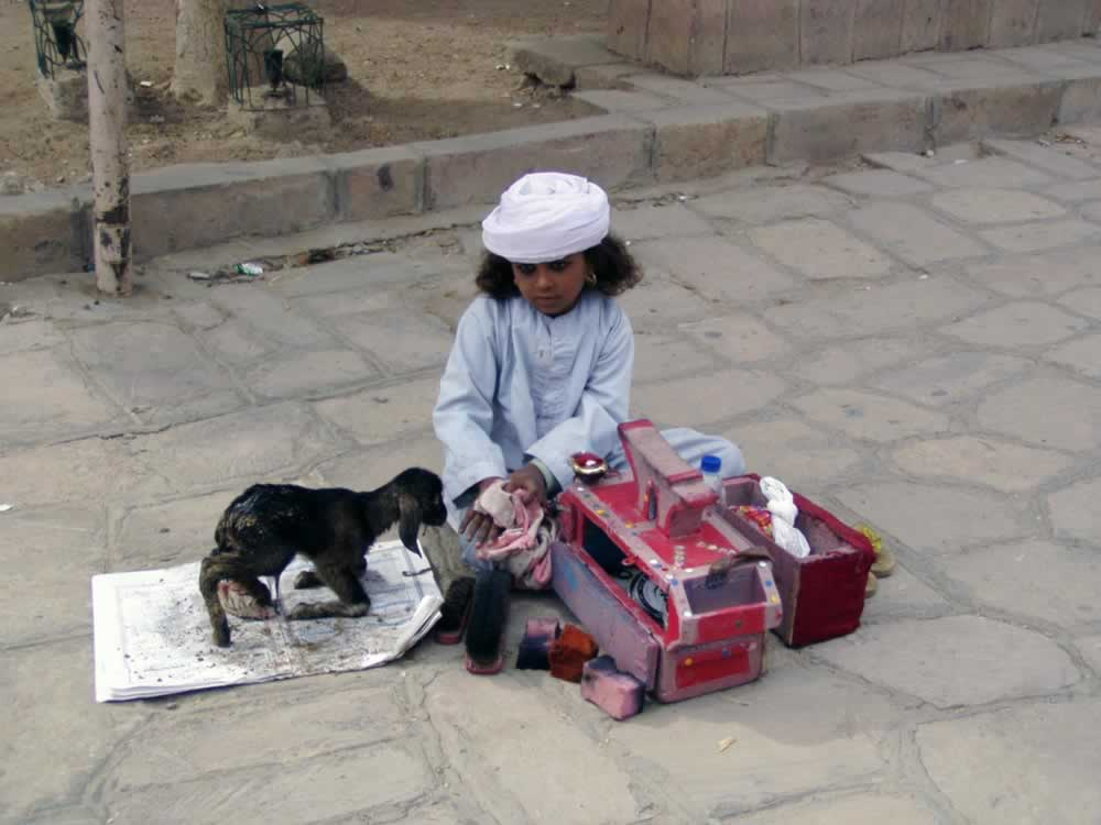 Girl and newborn kid in Luxor, Egypt