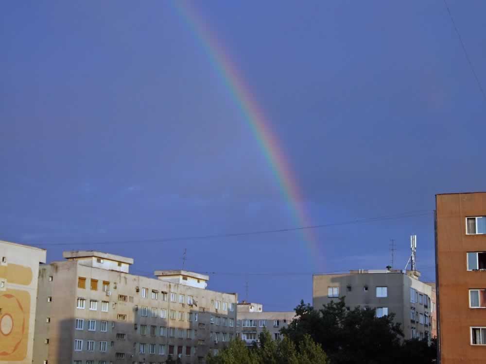 Rainbow over communist buildings in Drumul Taberei, Bucharest, Romania