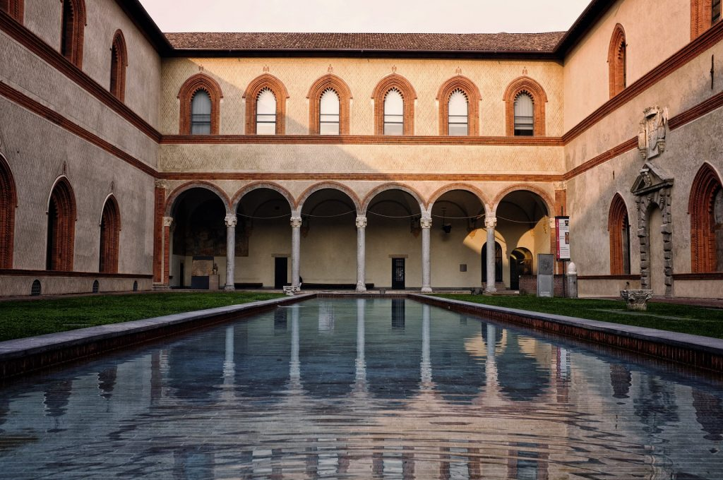 sforzesco castle courtyard with pond