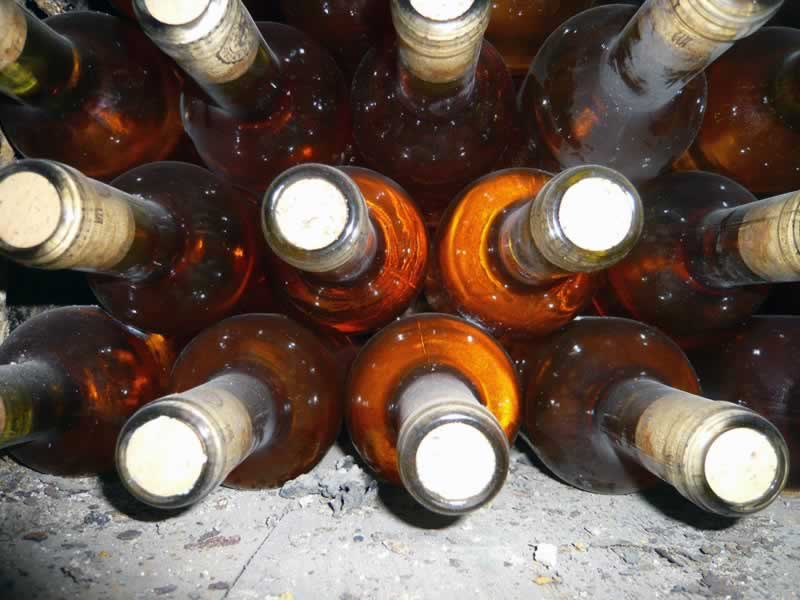 Liquid gold - old wine bottles