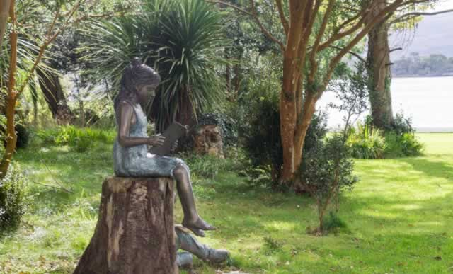 kenmare statue of a girl reading
