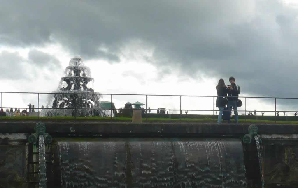 versailles fountain, lovers and a dramatic sky