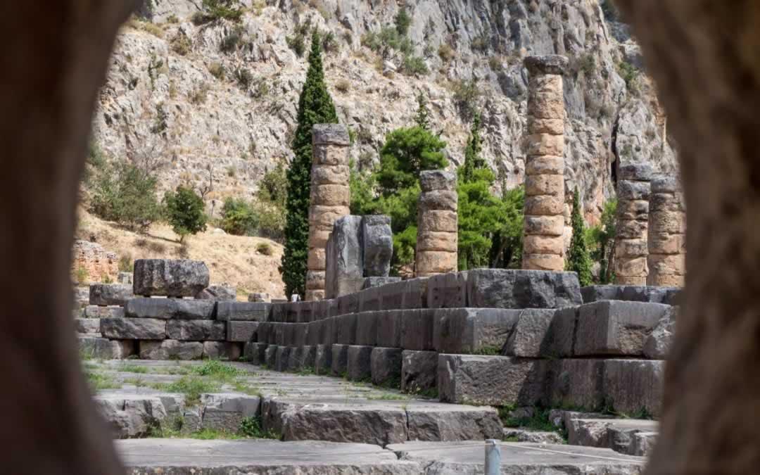 Temple of Apollo in Delphi, Greece, seen through a peephole