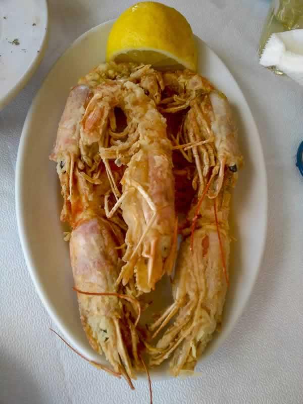 Fried Shrimps on Plate with Lemon