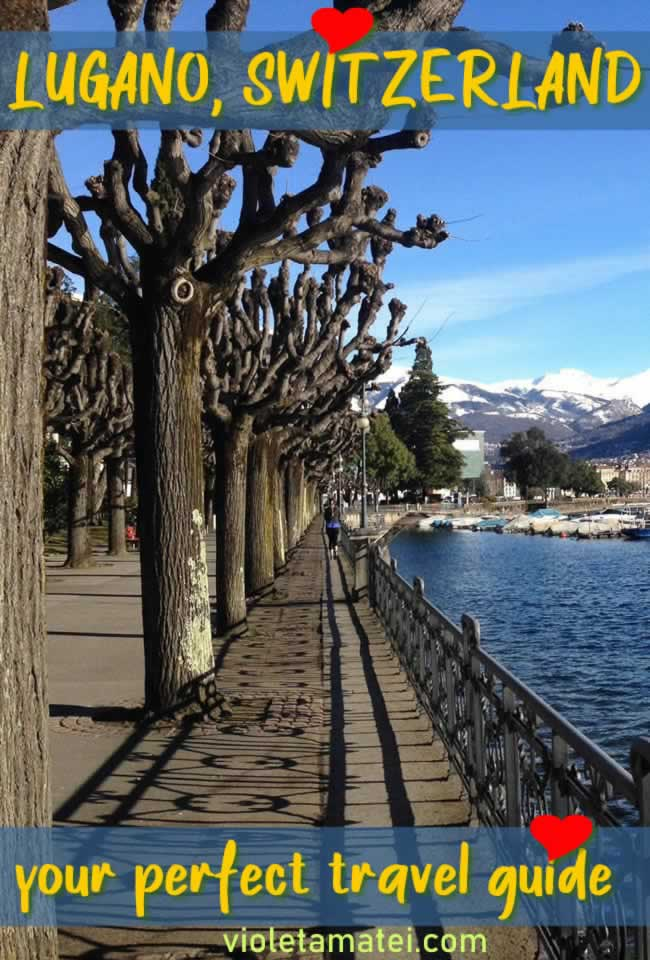 Lugano Switzerland - lake front promenade with pruned trees ans snowy mountains in background