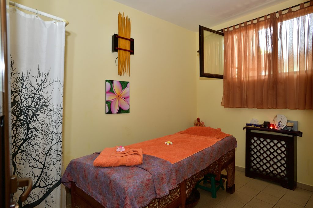 Medical spa treatment room with bed and window