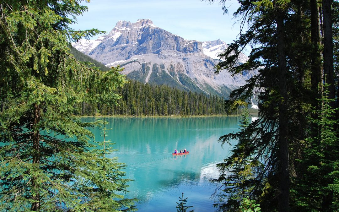 Canada ssecret destinations, lake with trees and snowy mountain