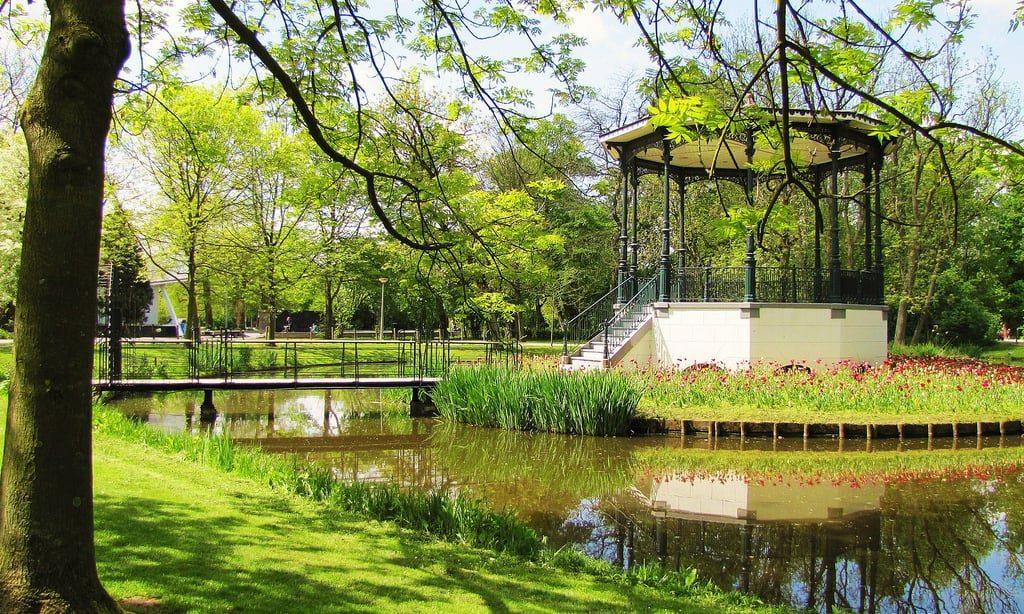 Vondelpark Amsterdam green trees and lake