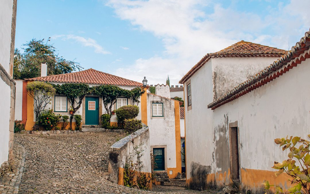 The cobblestone streets of Obidos Portugal are only one of the many reasons to visit this town during your trip to Portugal