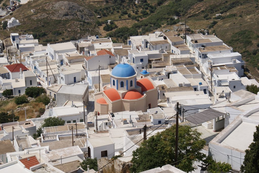 Greek village with whitewashed church on Serifos Island