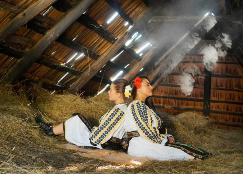 Girls in hay, in Romania