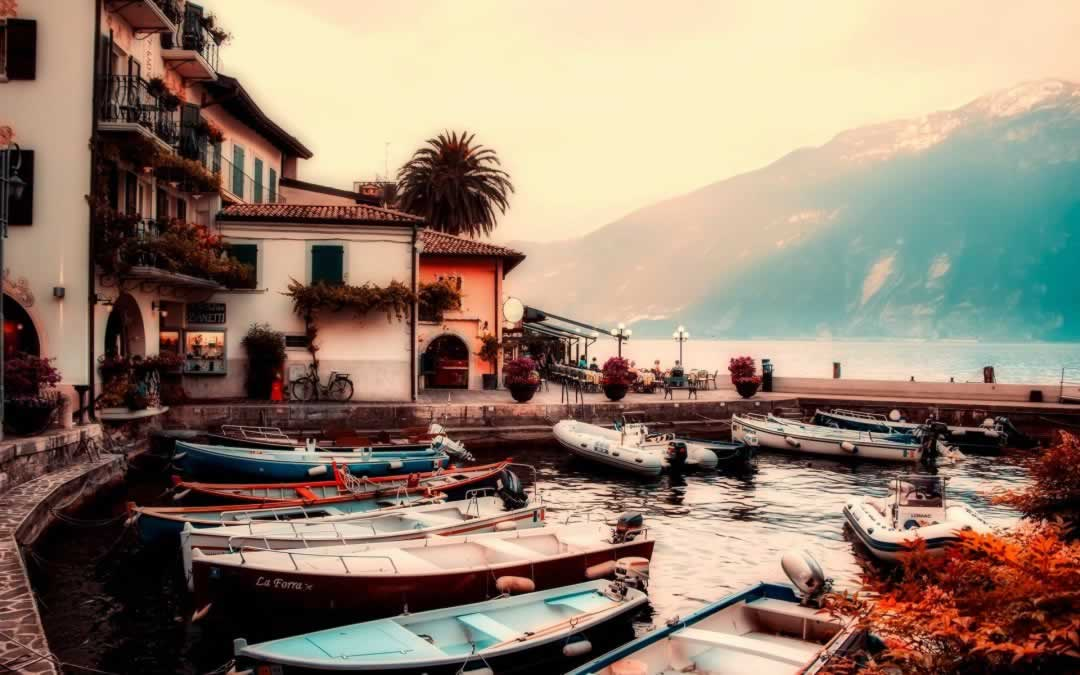 Lake Garda with boats by the sunset, with colorful sky
