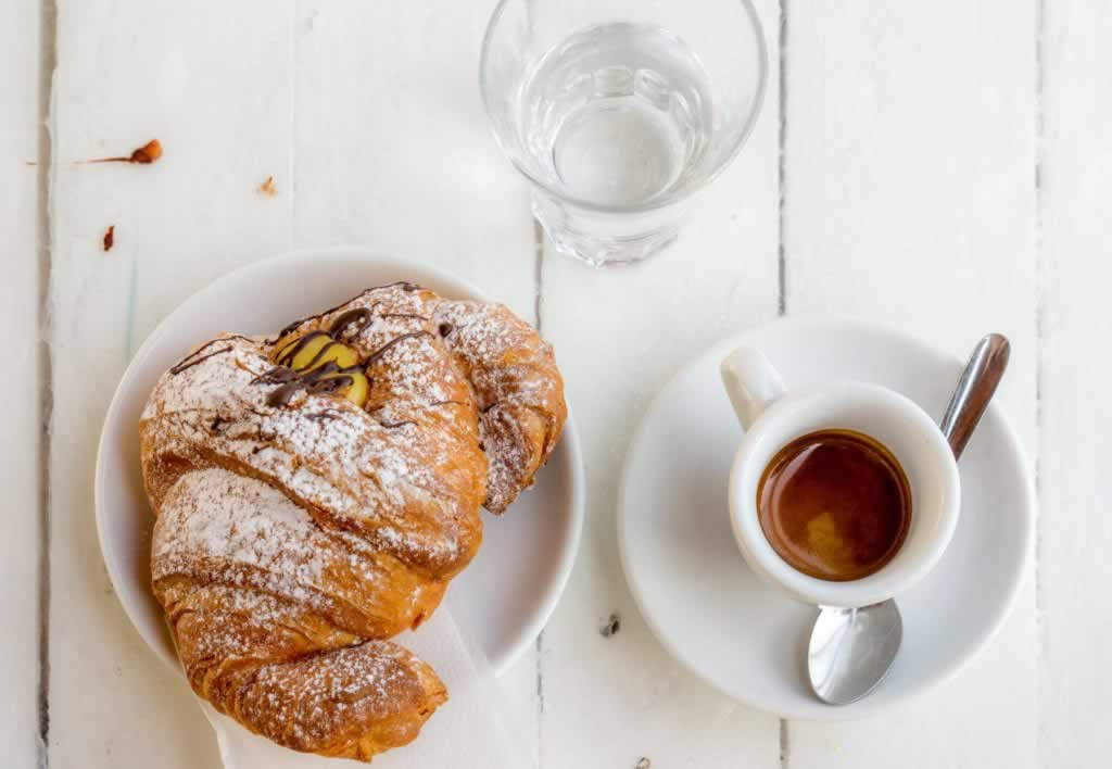 Coffee and croissant in Ostia, near the train station