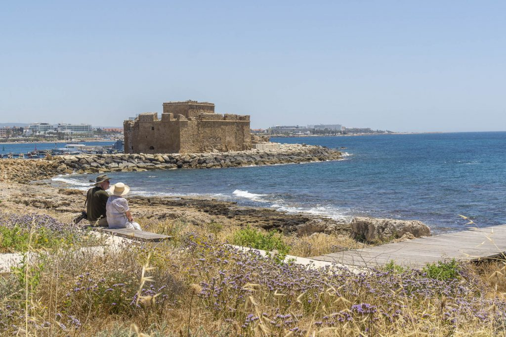 Paphos coastal walk towards the entrance to the archeological park with the Castle in sight