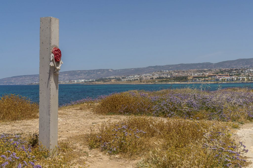 Paphos coastal walk towards the entrance to the archeological park with monuments